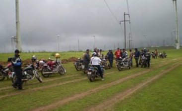 Monsoon Madness - Riders halt for capturing snaps at the top of wind mill farms in Chalkewadi
