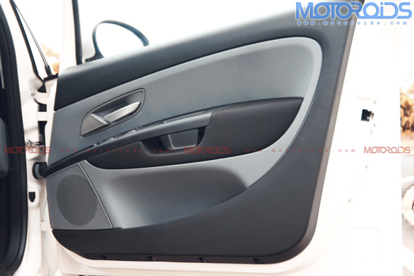 Plastic quality on the inner door panel improved like the other interiors