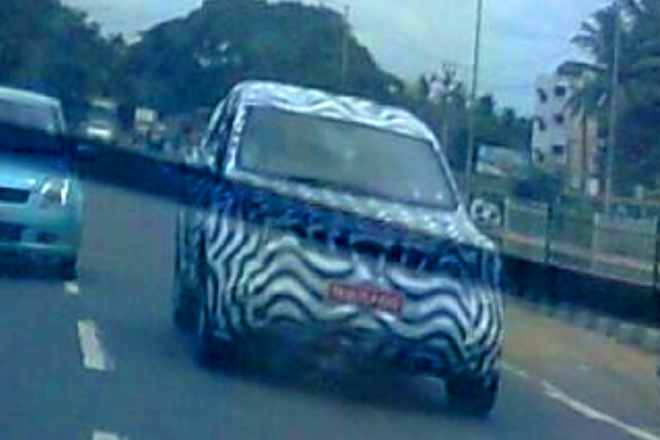Mahindra & Mahindra's new, 2011 world SUV, codenamed W201 caught in its final testing stages. Details on price, launch and specifications on Motoroids.com