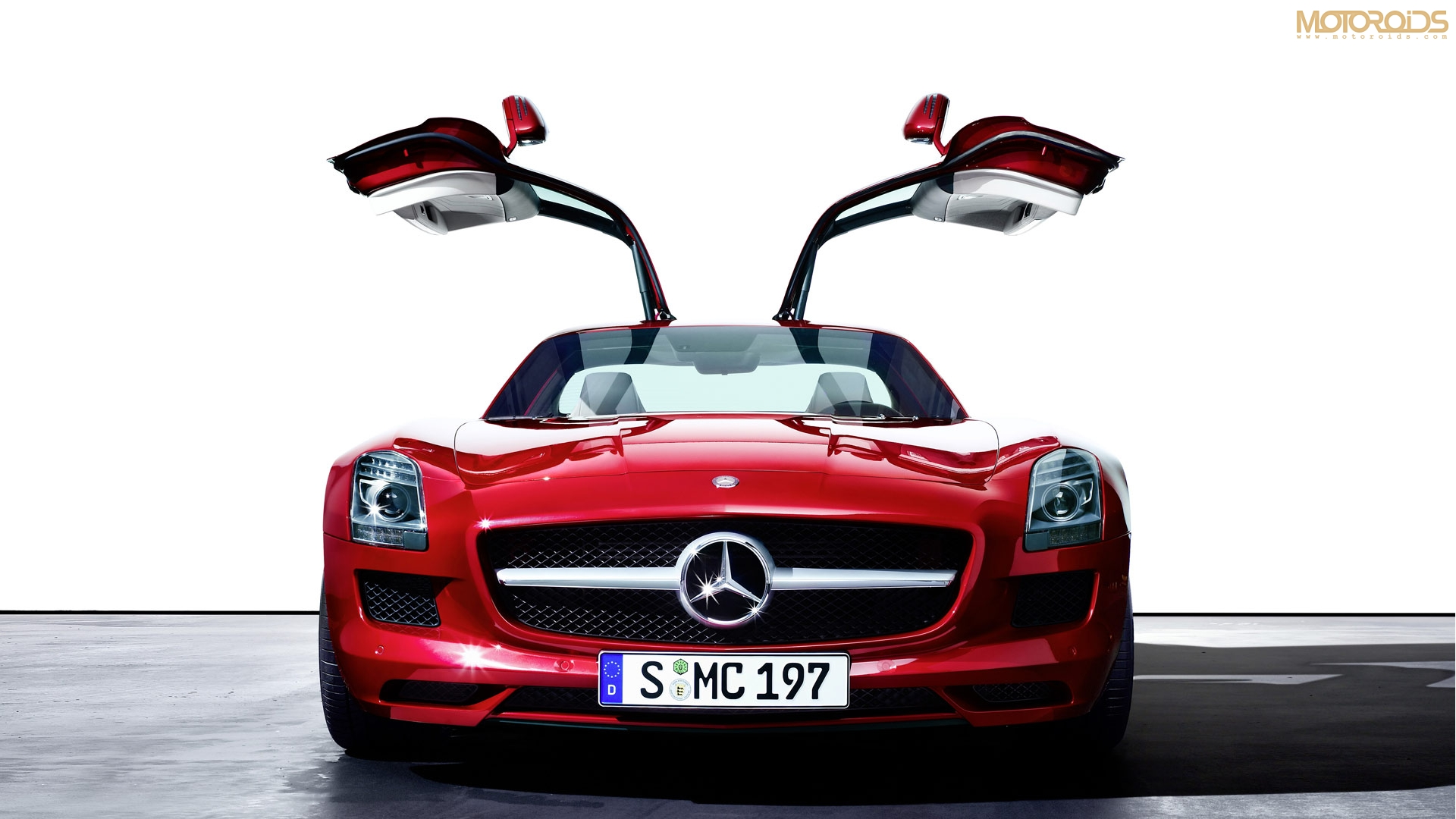 The Mercedes Benz SLS AMG has been launched in India. Price, delivery details, specifications and wallpapers/photos available on Motoroids.com