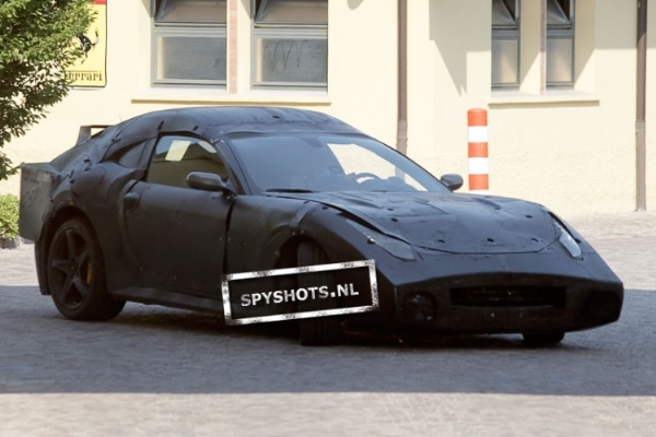 A mysterious looking Ferrari test mule has been spotted near the Ferrari factory in Maranello. Could be a 612 Scaglietti replacement of the 458 Italia Special Edition or a new model altogether! Photos & Video on Motoroids.com