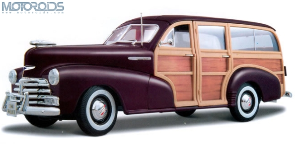 Chevrolet shows a one-off Beat / Spark Woody art car which is inspired by the Woody Wagon and the surf board movement of the 50s/60s USA