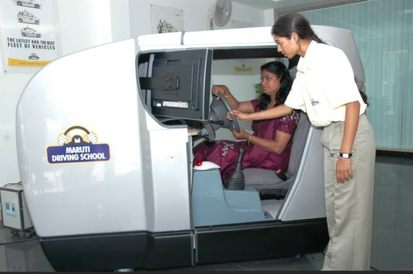 A woman getting training on safe driving practices at the Maruti Suzuki managed IDTR