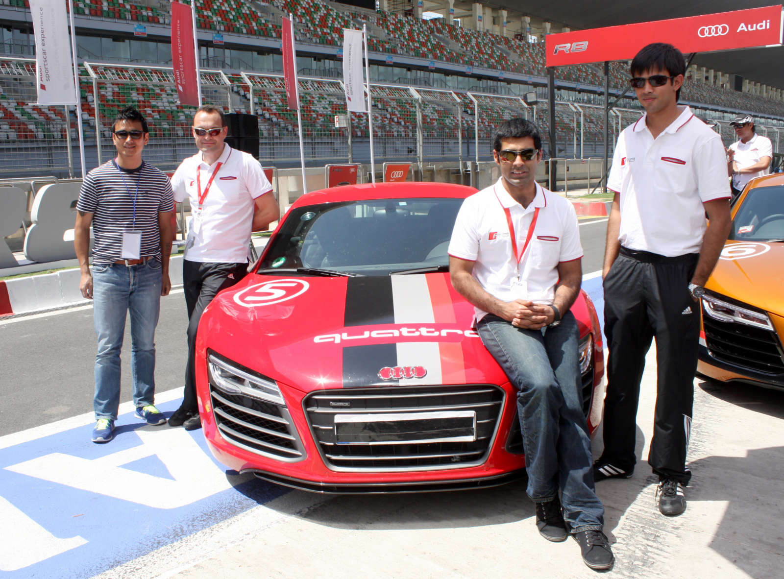 From Left to Right - Indian Football Icon, Baichung Bhutia, Michael Perschke, Head, Audi India, Ace Drivers Karun Chandhok and Aditya Patel at the launch of Audi R8 V10 Plus at BIC-1