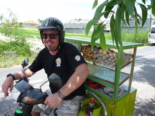 Charley Boorman on a challenge to sell some local Indonesian cuisine on a bike while filming Freedom Riders Asia in Bali