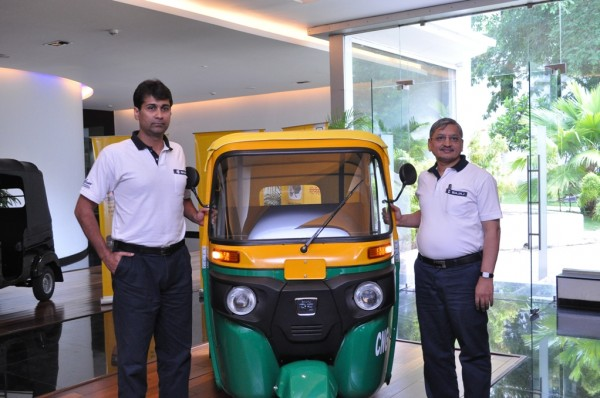 Mr. Rajiv Bajaj, MD and Mr. R C Maheshwari, President - CV Bajaj Auto Ltd. with the newly launched RE - Compact