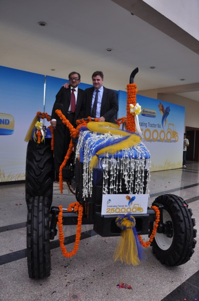 Mr. Rakesh Malhotra, Head of New Holland Fiat India,Mr Stefano Pampalone, Head of Operations for India, Pakistan, Far East and Japan at the Celebration to mark rollout of New Holland's 2,50,000th tractor3