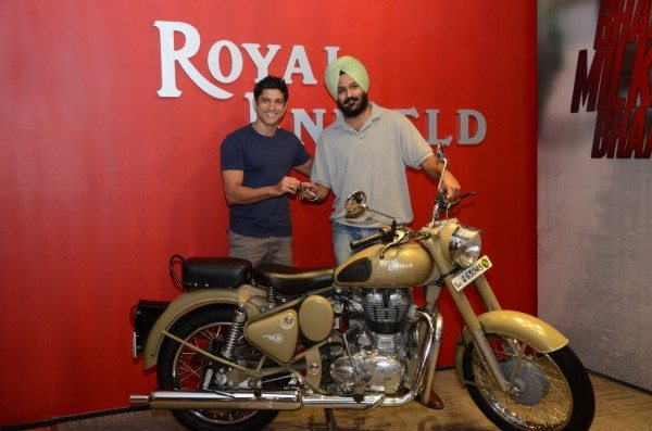 Farhan Akhtar giving away the Royal Enfield Desert Storm to Hamininder Singh