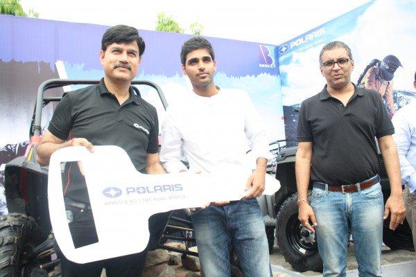 Mr Pankaj Dubey - MD Polaris India Handing over the keys of RZR S 800 to Cricketer Bhuvenshwar Kumar along with Bhavnish Mediratta (Beekay Motors - MD)