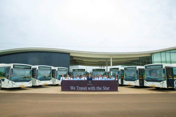 Mr. Eberhard Kern, MD and CEO, Mercedes-Benz India along with employees at the launch of the city bus service for the employees at Chakan, Pune