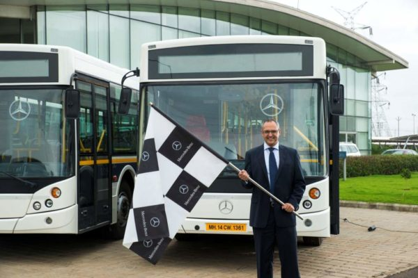 Mr. Eberhard Kern,MD and CEO, Mercedes-Benz India flags off the city buses for employees from the Chakan Plant today