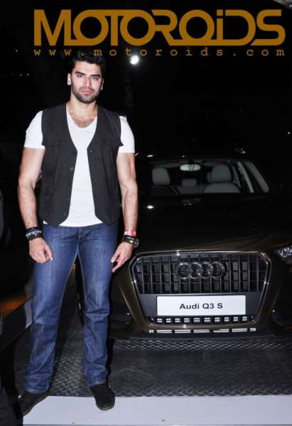 Actor, Niketan Dheer posing with the Audi Q3 S Edition at the Audi Autumn Collection showcasing in Mumbai