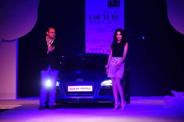 Audi India Head Mr Michael Perschke and global Indian actress Freida Pinto posing with New Audi R8 V10 Plus at Audi Autumn Collection 2014 Showcase du