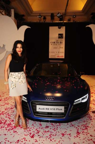 Global Indian Actress, Freida Pinto posing with New Audi R8 V10 plus at Audi Autumn Collection 2014, Delhi