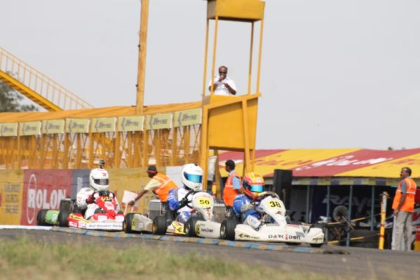 Kush Maini leads Krishnaraaj Mahadik in Junior Max Heats of the JK Tyre-FMSCI National Rotax Max Karting Championship 2013 Round 3 in Coimbatore on Saturday