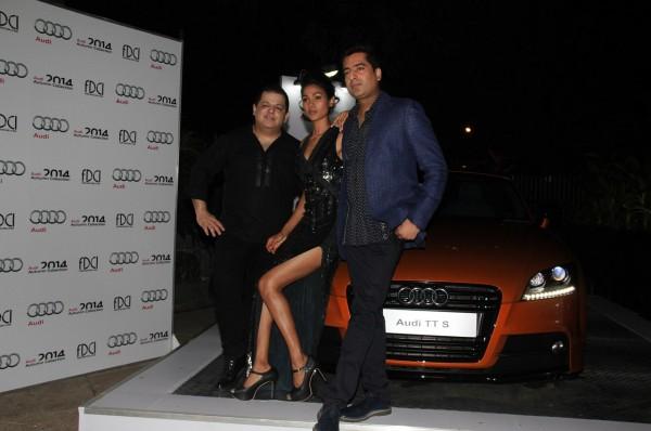 L-R-Designer duo, Rohit Gandhi & Rahul Khanna with model, Nethra Raghuraman posing with the Audi TT
