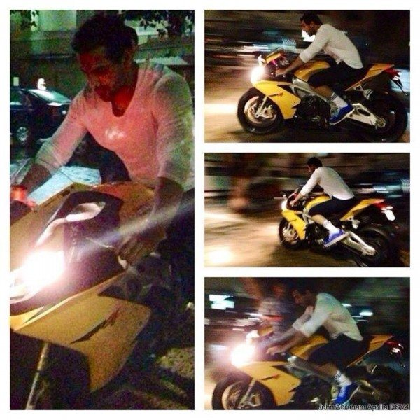 John Abraham sets a bad example by riding an Aprilia RSV4 without a Helmet