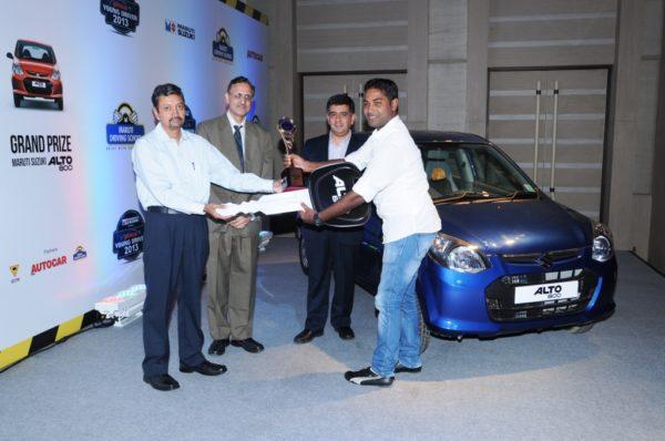 (L-R). Manohar Bhatt, Vice President, Marketing, Maruti Suzuki India,Mahesh Rajoria-Director,IDTR,Hormazd Sorabjee, Editor, Autocar India with winner Mr. Smruti Ranjan Das