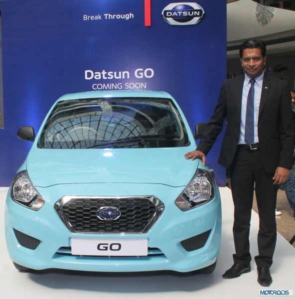 Pic 1 - Mr. John Kullu along with the Datsun Go