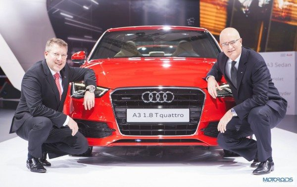 Mr. Terence Johnsson, Vice-President, Overseas Sales of AUDI AG (Sitting in Right - Blue Tie) and Mr. Joe King, Head, Audi India (Sitting in Left - Red Tie) with the Audi A3 Sedan at Auto Expo 2014