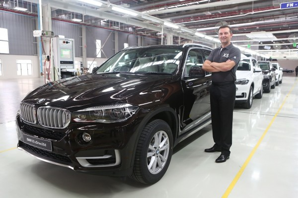 Robert Frittrang, Managing Director, BMW Plant Chennai with the all-new BMW X5 as it rolls out of BMW Plant Chennai.