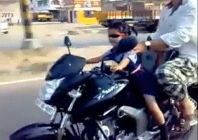 Toddler riding a motorbike