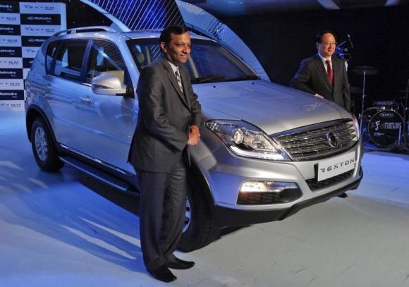 Goenka and Yoo-Il pose with newly-launched Ssangyong Rexton SUV vehicle in Mumbai