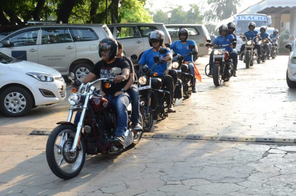 Harley Owners Group riders escort the FC Goa team bus to the stadium