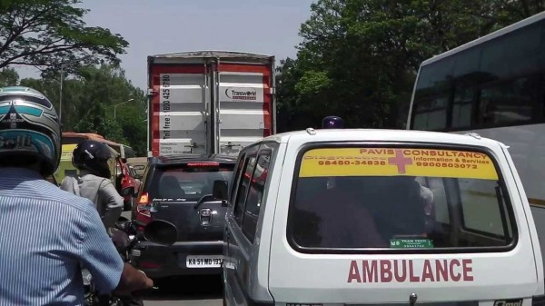 A ambulance stuck in a traffic jam with no one giving way.