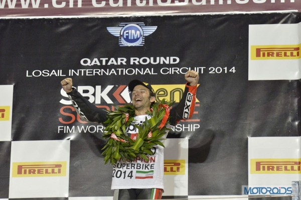 Guintoli-Wins-WSBK-2014-Stands-At-Podium (1)