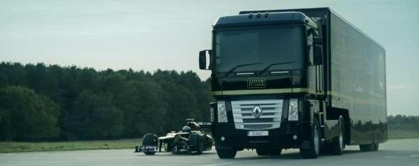 Sem-Truck jumping over speeding F1 car