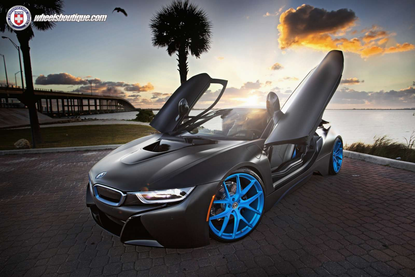 This Matte Black Wrapped Bmw I8 With Blue Hre Wheels Looks The Part Motoroids