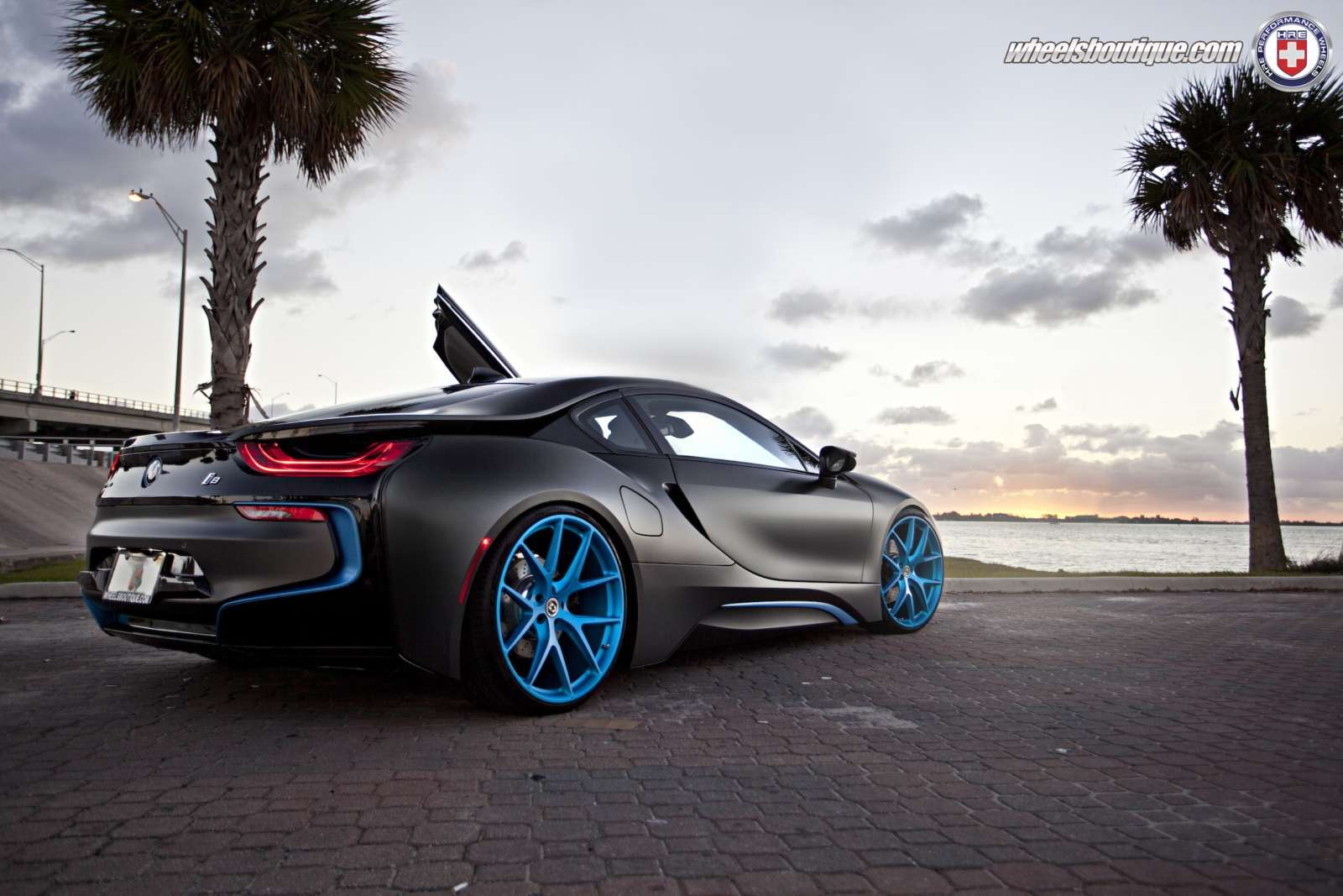 This Matte Black Wrapped Bmw I8 With Blue Hre Wheels Looks