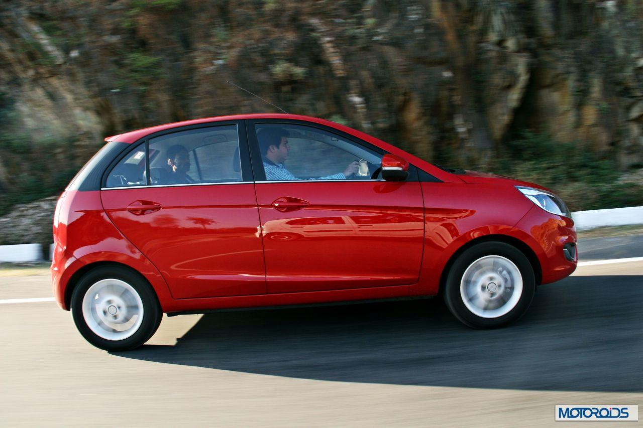 Tata Bolt Red Action Side 7 Motoroids Com
