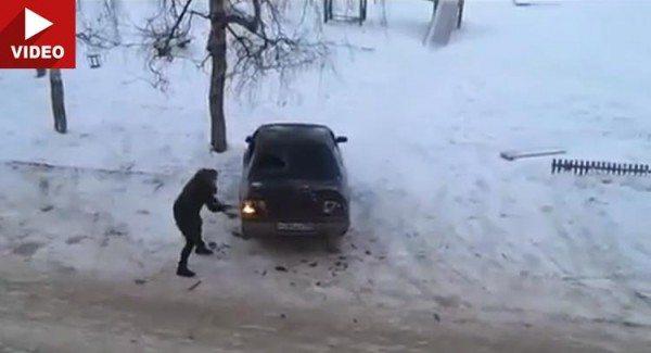 Woman-attacks-car-with-axe
