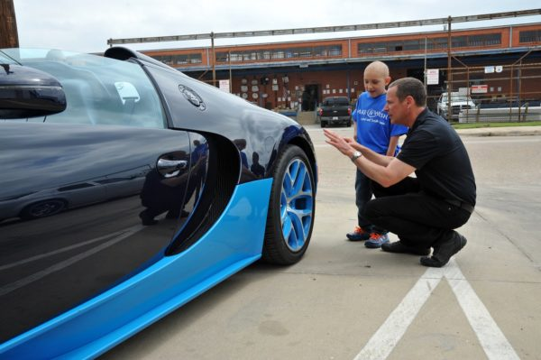 Leukemia kid rides in Bugatti Veyron