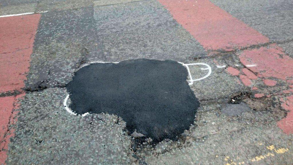 wanksy artist pothole graffiti (2)