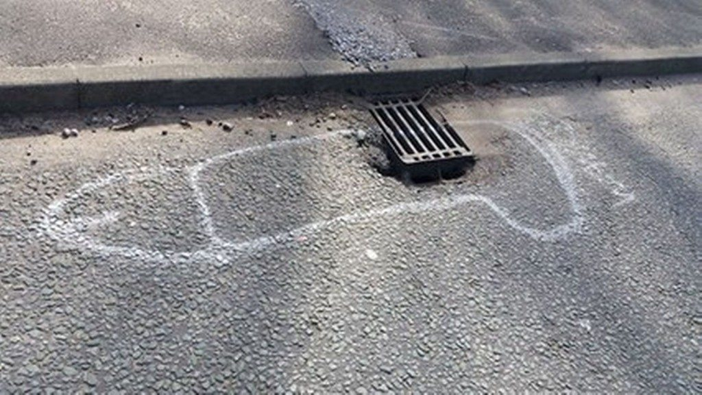 wanksy artist pothole graffiti (3)