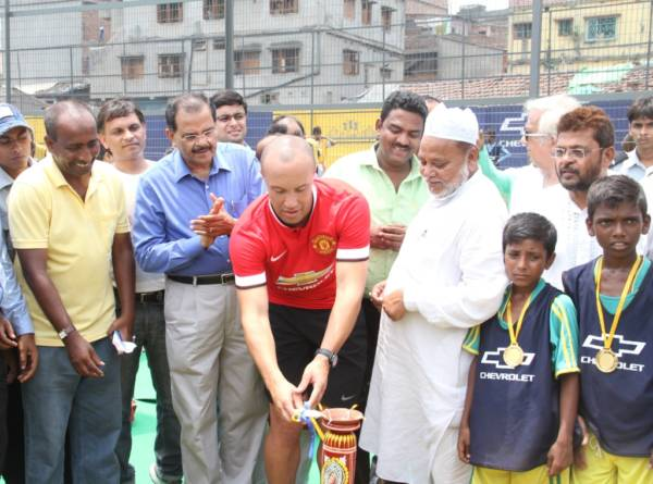 P Balendran, VP - GM India (2nd from Left) and Mikael Silvestre - Man United legend (in Red T-shirt) inaugrate the renovated Rebecca Belilious Sports Ground in Kolkata on Saturday