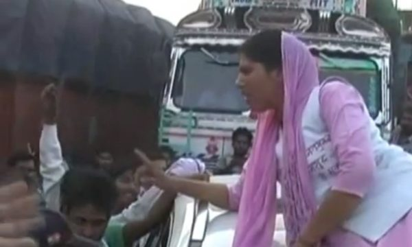 Woman protesting on car