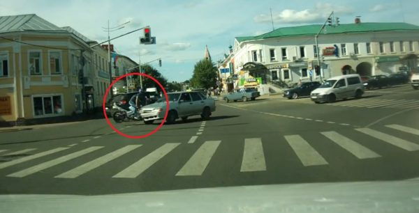 Motorcyclist runs into taxi in Russia - 2