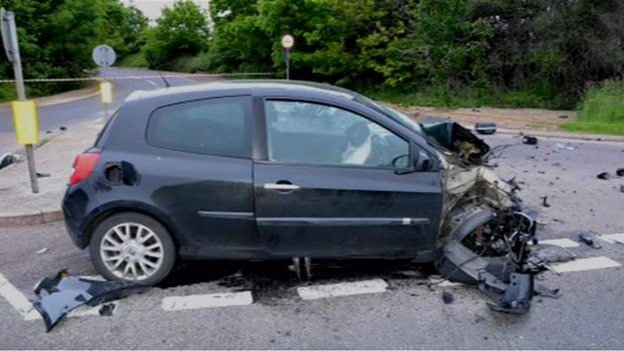 The car sustained irreparable damage, thoughthe driver survived