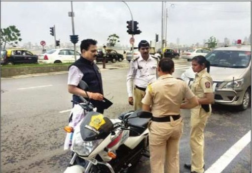 Traffic cops riding without helmets caught by Transport Minister Diwakar Raote