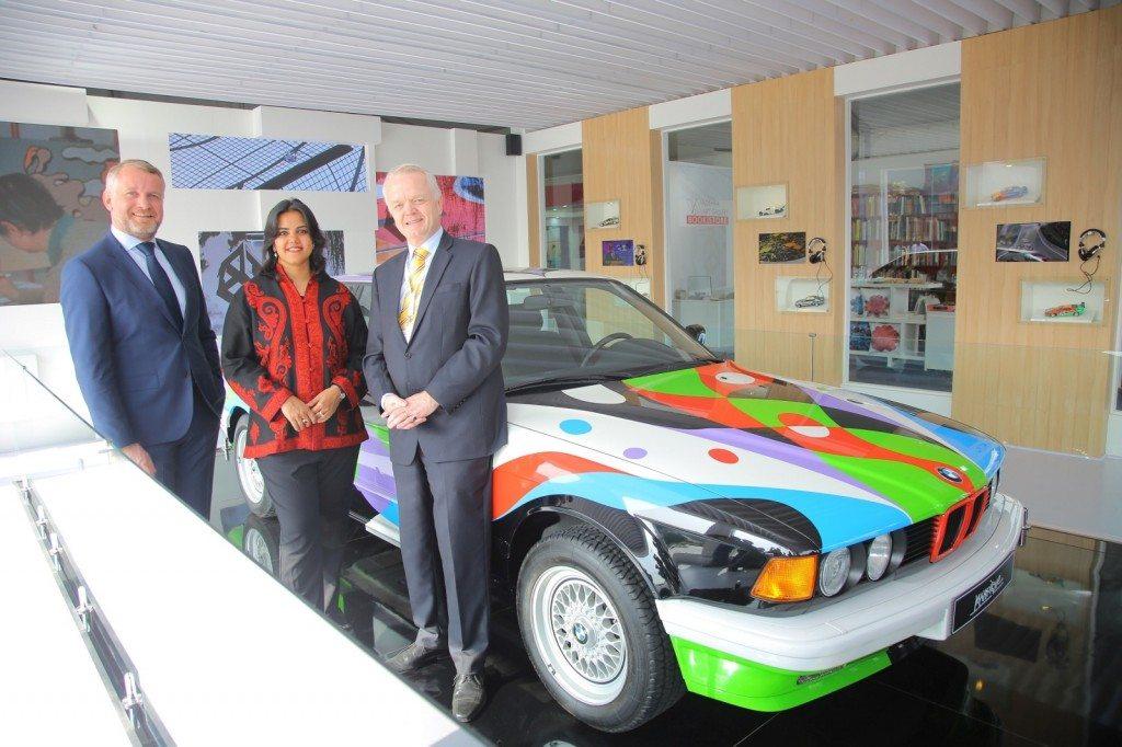 02 (L TO R) Dr. Thomas Girst, Mr. Neha Kirpal and Mr. Philipp von Sahr with BMW Art Car by César Manrique