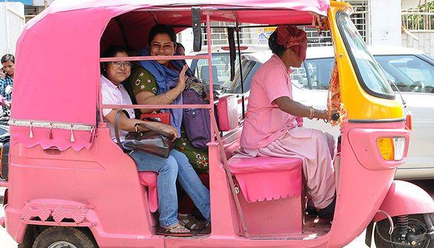 Pink auto ferrying woam passenger