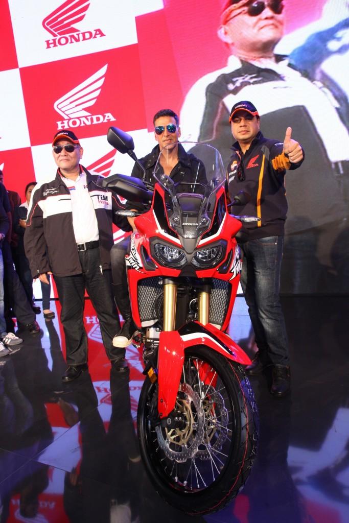 Akshay Kumar poses on the Africa Twin motorcycle at Honda 2Wheelers pavilion at Autp Expo