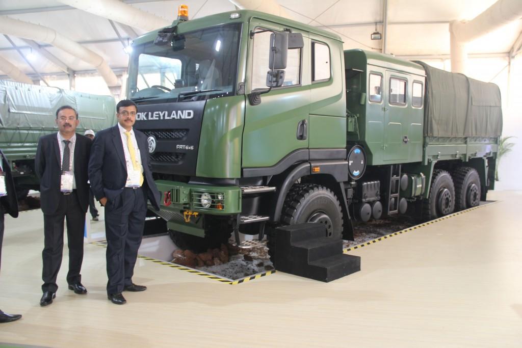 (Left to Right) - Mr. Nitin Seth, President - LCV & Defence, Ashok Leyland and Mr. Vinod Dasari, MD, Ashok Leyland with Field Artillery Tractor 6x6