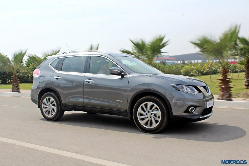 new 2016 Nissan X-Trail Hybrid India grey action (4)
