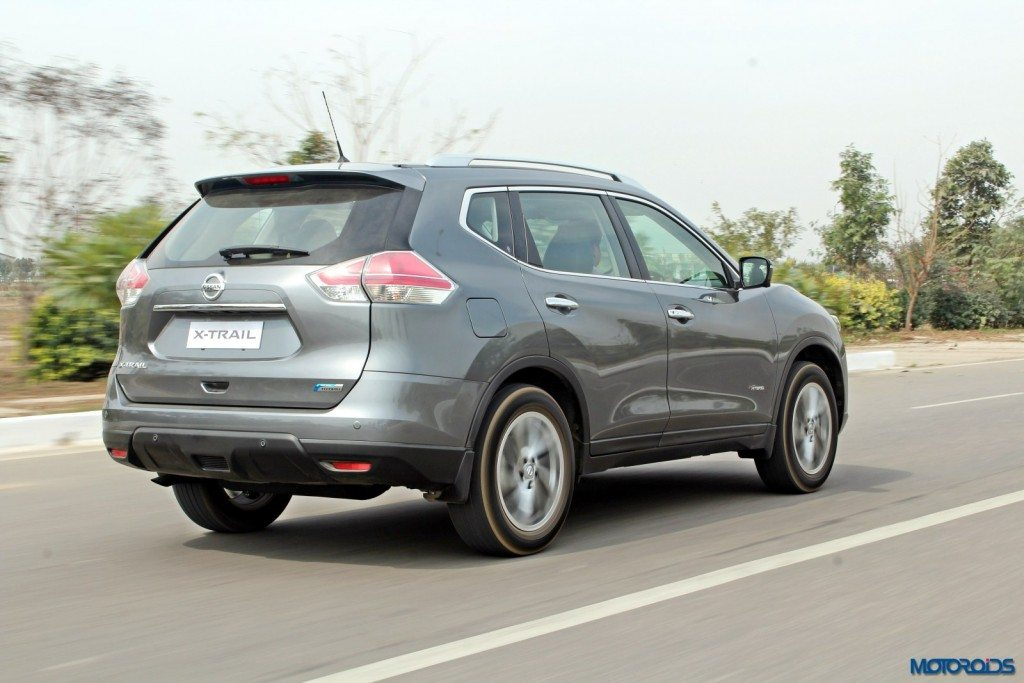 new 2016 Nissan X-Trail Hybrid India grey action rear (3)