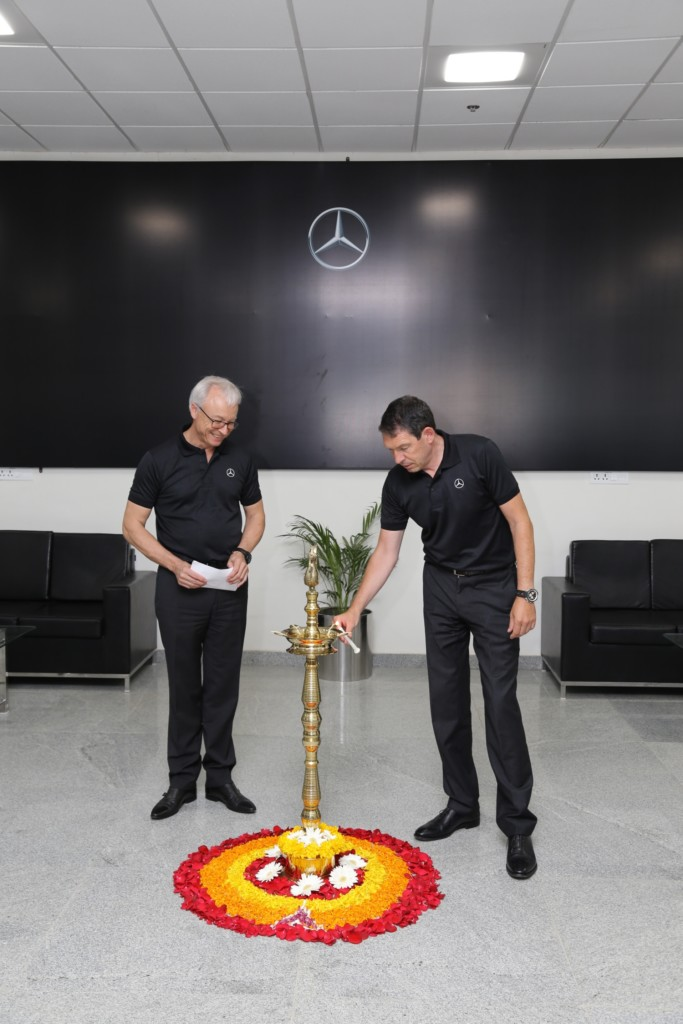 dr-till-conrad-head-region-overseas-mercedes-benz-cars-and-mr-roland-folger-md-ceo-mercedes-benz-indialighting-the-lamp-at-the-inauguration-of-vpc